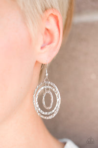 Delicately hammered in rippling shimmer, three silver hoops swing from the ear, joining into a dizzying lure. Earring attaches to a standard fishhook fitting.  Sold as one pair of earrings.  Always nickel and lead free.