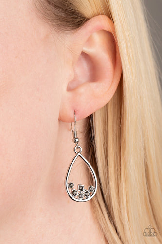 Varying in shape, a collection of dainty smoky rhinestones collect at the bottom of an airy silver teardrop frame for a timeless finish. Earring attaches to a standard fishhook fitting. Sold as one pair of earrings.  Always nickel or lead free.
