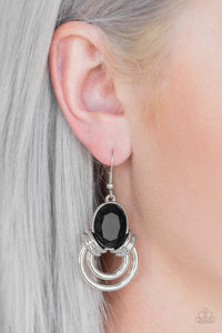 Shimmery silver hoops radiate from the bottom of a dramatic black gem fitting, coalescing into a regal frame. Earring attaches to a standard fishhook fitting.  Sold as one pair of earrings.  Always nickel and lead free.
