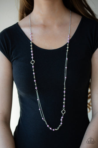 A collection of purple pearls, twisting silver hoops, and faceted silver beads trickle along an asymmetrical silver chain for a refined look. Features an adjustable clasp closure.  Sold as one individual necklace. Includes one pair of matching earrings. Always nickel and lead free.