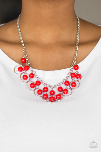 Polished red beads and shimmery silver hoops drip from the bottom of a glistening silver chain, creating a playful fringe below the collar. Features an adjustable clasp closure.  Sold as one individual necklace. Includes one pair of matching earrings.  Always nickel and lead free.