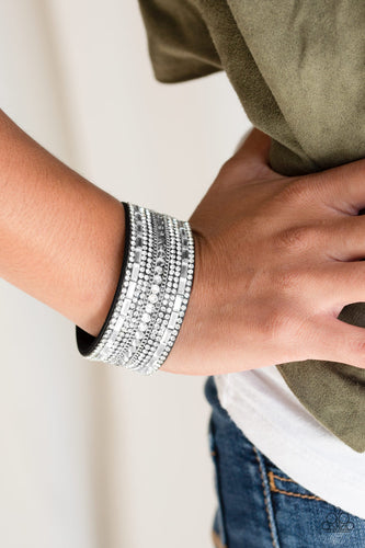 Featuring classic round and edgy emerald style cuts, glittery white rhinestones and glistening silver chains are encrusted along bands of black suede for a sassy look. Features an adjustable snap closure.  Sold as one individual bracelet.  P9DI-URBK-167XX  Always nickel and lead free.