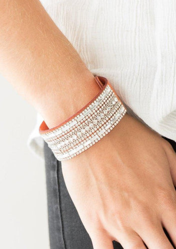 Featuring classic round and edgy emerald style cuts, glittery white rhinestones and glistening silver chains are encrusted along bands of orange suede for a sassy look. Features an adjustable snap closure.  Sold as one individual bracelet.   Always nickel and lead free.