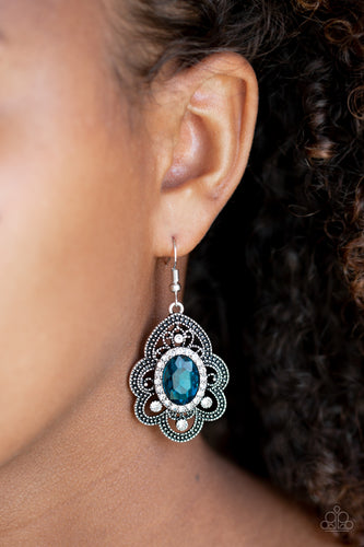 Radiating with studded detail, antiqued silver petals flare from a white and blue rhinestone encrusted center for a regal look. Earring attaches to a standard fishhook fitting.  Sold as one pair of earrings.  Always nickel and lead free.