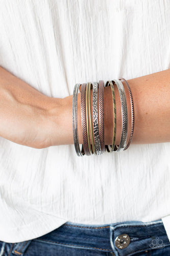Featuring smooth, studded, hammered, and textured finishes, a mismatched collection of copper, brass, and silver bangles stack across the wrist for a seasonal look.  Sold as one set of nine bracelets.  Always nickel and lead free.