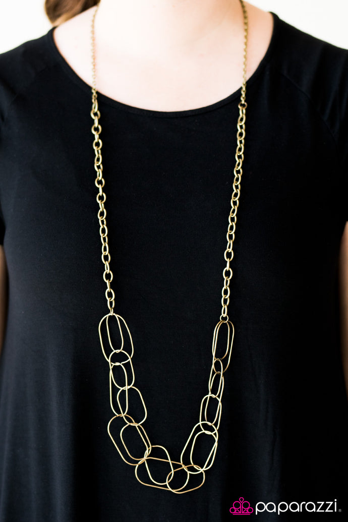 Glistening brass accents join into a web of layered chains. Brushed in a glistening finish, classic brass chains gives way to sections of bolder links as it drapes across the chest for a retro finish. Features an adjustable clasp closure.  Sold as one individual necklace. Includes one pair of matching earrings.  Always nickel and lead free.
