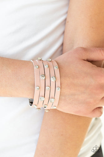 Dotted with glassy white rhinestones, a thick pink leather band has been spliced into five glittery strands around the wrist for a sassy look. Features an adjustable snap closure.  Sold as one individual bracelet.  Always nickel and lead free.