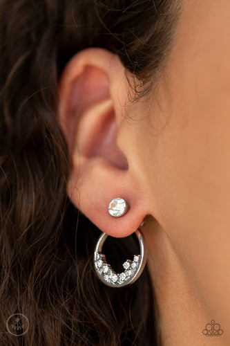 A solitaire white rhinestone attaches to a double-sided post, designed to fasten behind the ear. Encrusted in dainty white rhinestones, the circular double-sided post peeks out beneath the ear for a bold look. Earring attaches to a standard post fitting.  Sold as one pair of double-sided post earrings.   Always nickel and lead free.