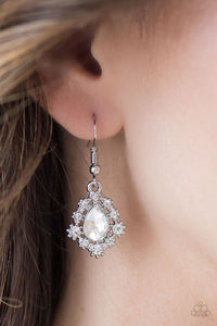 Dainty white rhinestones dance around a shimmery white teardrop, creating a regal frame. Earring attaches to a standard fishhook fitting.  Sold as one pair of earrings.  Always nickel and lead free.