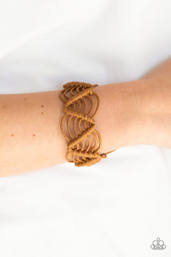 Brown twine knots around shiny brown cording, creating a netted pattern around the wrist. Features an adjustable sliding knot closure.  Sold as one individual bracelet.  Always nickel and lead free.