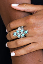 Load image into Gallery viewer, Dainty turquoise stones are pressed into ornate silver frames, coalescing into an earthy frame atop the finger. Features a stretchy band for a flexible fit.  Sold as one individual ring.  Always nickel and lead free.