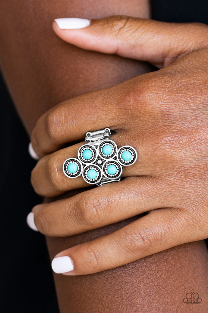 Dainty turquoise stones are pressed into ornate silver frames, coalescing into an earthy frame atop the finger. Features a stretchy band for a flexible fit.  Sold as one individual ring.  Always nickel and lead free.
