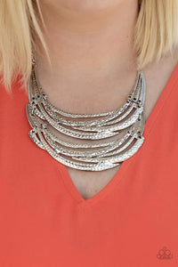 Stamped in sections of vine-like patterns, abstract hammered plates and overlapping silver bars link into an exaggerated pendant below the collar for a statement-making look. Features an adjustable clasp closure.  Sold as one individual necklace. Includes one pair of matching earrings.  Always nickel and lead free.  Life of the Party September 2020