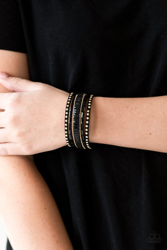 Shiny gold studs, dainty gold ball chains, and edgy black emerald-cut rhinestones race along a spliced black suede band for a rock star look. Features an adjustable snap closure.  Sold as one individual bracelet.  Always nickel and lead free.