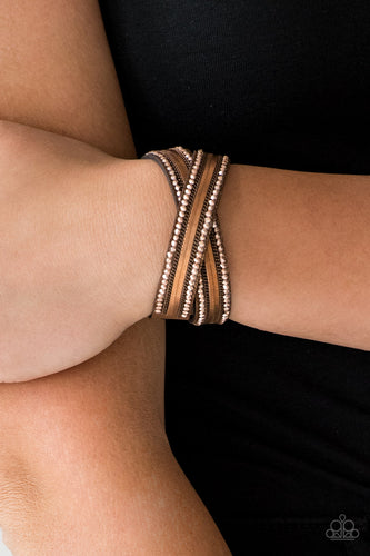 Rows of classic copper chain, flat copper chain, and dainty metallic rhinestones are encrusted along a brown suede band dusted in golden sparkles for a sassy look. The elongated band allows for a trendy double wrap design. Features an adjustable snap closure.  Sold as one individual bracelet.  Always nickel and lead free.