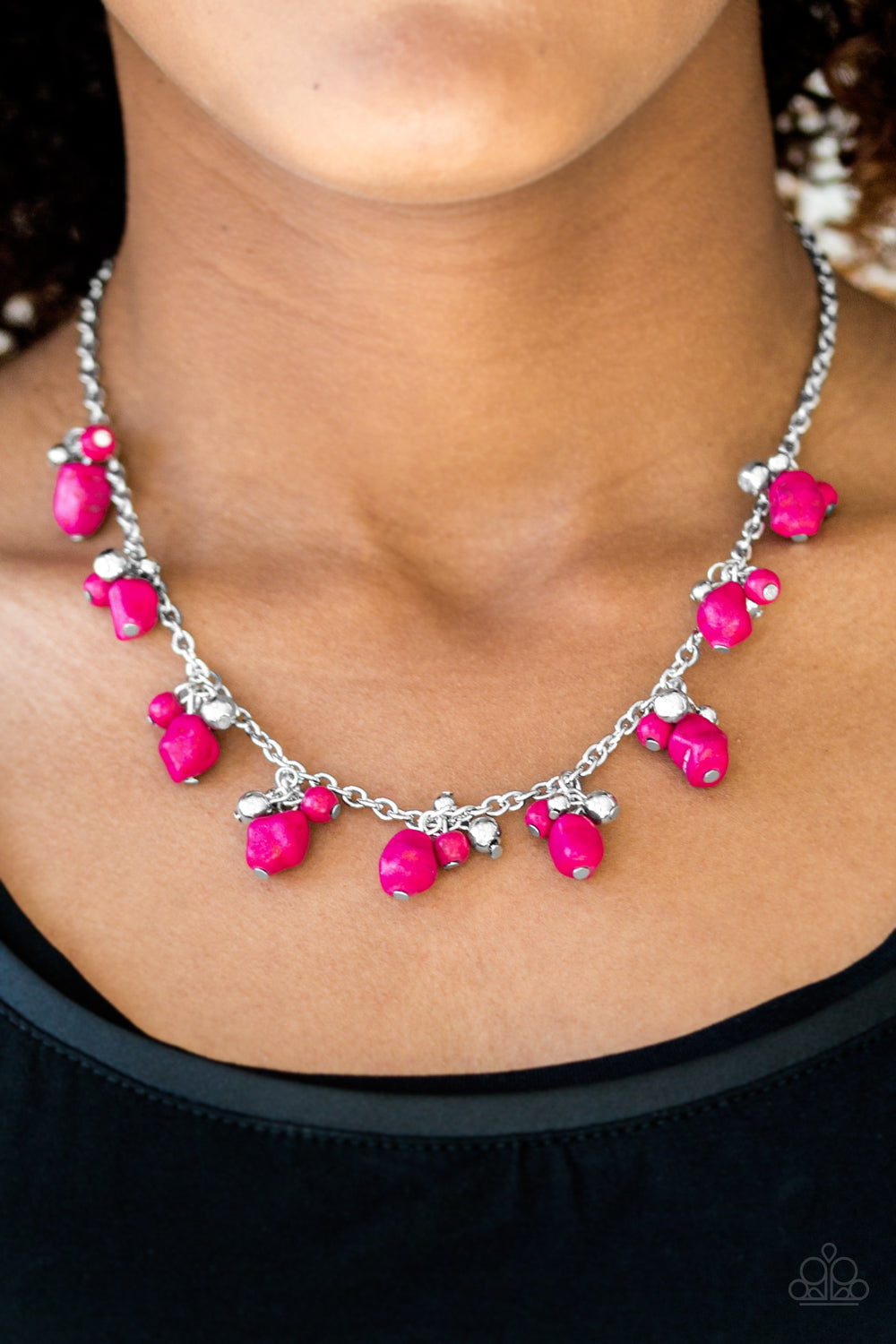 Varying in shape and size, shiny silver beads and vivacious pink stone beading swing from the bottom of a shimmery silver chain, creating a colorful fringe below the collar. Features an adjustable clasp closure.  Sold as one individual necklace. Includes one pair of matching earrings.  Always nickel and lead free.