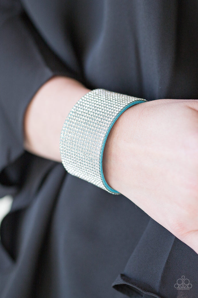 Row after row of glassy white rhinestones are encrusted along a thick blue suede band, creating knockout shimmer across the wrist. Features an adjustable snap closure.  Sold as one individual bracelet. Always nickel and lead free.