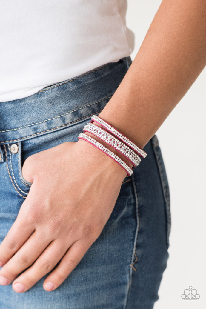 Rows of glassy white rhinestones and a shimmery silver chain are encrusted along vibrant pink suede bands for a sassy look. Features an adjustable snap closure.  Sold as one individual bracelet.  Always nickel and lead free.