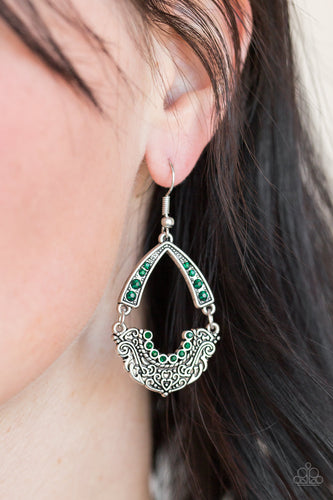 Encrusted in glittery green rhinestones, an arcing silver frame links with an ornate silver frame radiating with filigree filled details for a refined look. Earring attaches to a standard fishhook fitting.  Sold as one pair of earrings. Always nickel and lead free.