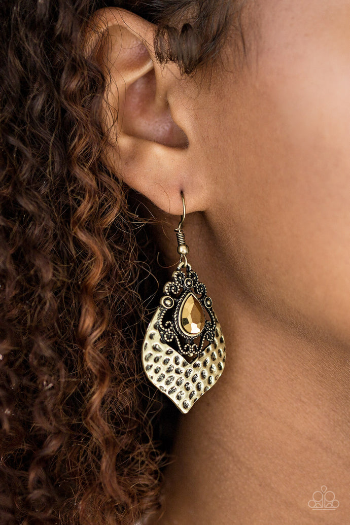 Cut into a regal teardrop, a faceted aurum rhinestone is pressed into an ornate lure. The bottom of the lure has been delicately hammered, adding shimmery texture to the regal palette. Earring attaches to a standard fishhook fitting.  Sold as one pair of earrings.  Always nickel and lead free.