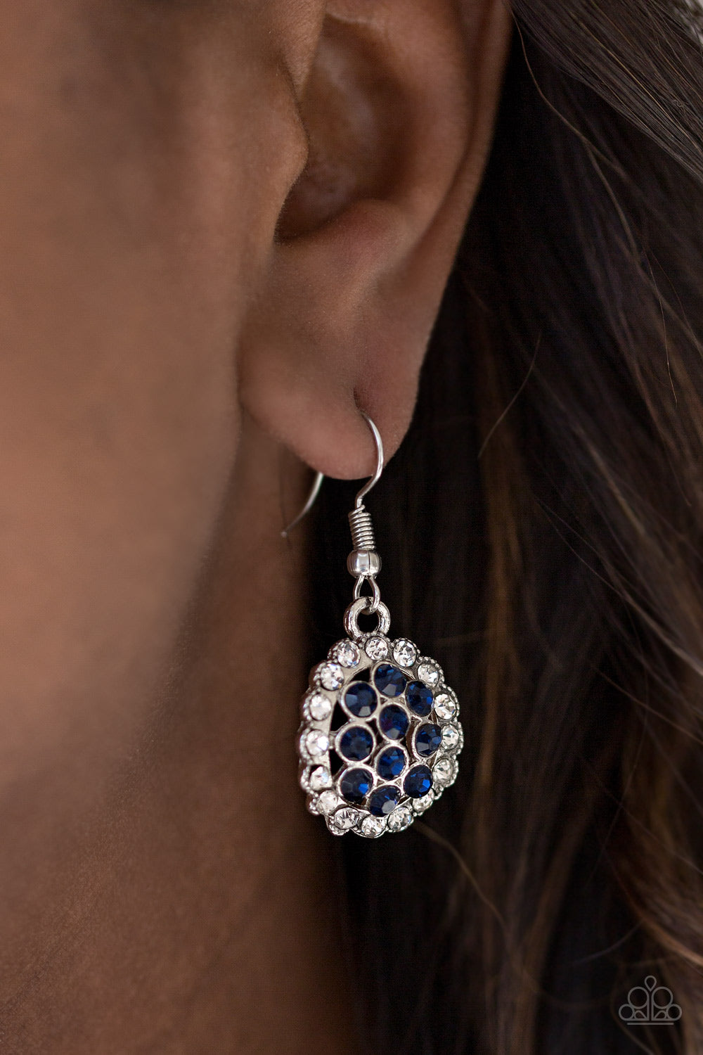 Dazzling white and blue rhinestones are encrusted across a round silver frame, creating a blinding palette. Earring attaches to a standard fishhook fitting.  Sold as one pair of earrings. Always nickel and lead free.