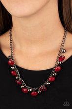 Load image into Gallery viewer, Featuring cloudy and glassy finishes, faceted red crystal-like beads swing from the bottom of a glistening gunmetal chain. Faceted gunmetal beads join the fiery beading, creating a flirtatious fringe below the collar. Features an adjustable clasp closure.  Sold as one individual necklace. Includes one pair of matching earrings.  Always nickel and lead free.