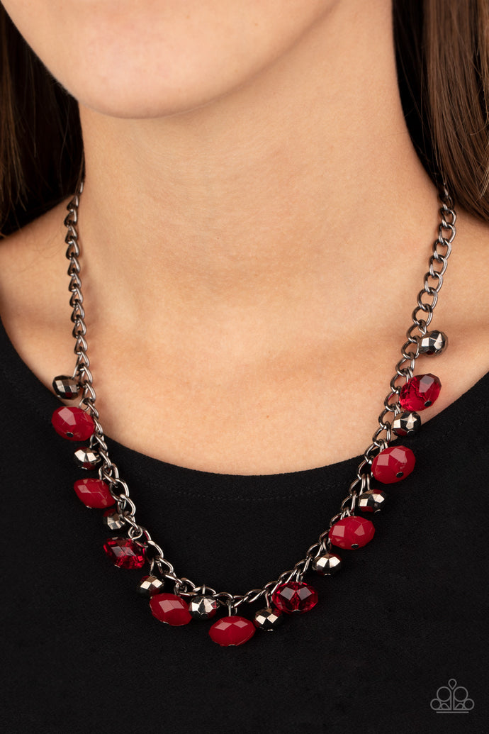 Featuring cloudy and glassy finishes, faceted red crystal-like beads swing from the bottom of a glistening gunmetal chain. Faceted gunmetal beads join the fiery beading, creating a flirtatious fringe below the collar. Features an adjustable clasp closure.  Sold as one individual necklace. Includes one pair of matching earrings.  Always nickel and lead free.