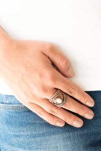 Embossed in shimmery filigree, glistening copper frames join around a refreshing white stone center for a seasonal look. Features a stretchy band for a flexible fit.  Sold as one individual ring.  Always nickel and lead free.