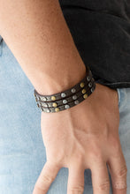 Load image into Gallery viewer, Split into three strands, antiqued brass and gunmetal beads are studded along the front of a brown leather band for a rustic look. Features an adjustable snap closure.  Sold as one individual bracelet.  Always nickel and lead free.