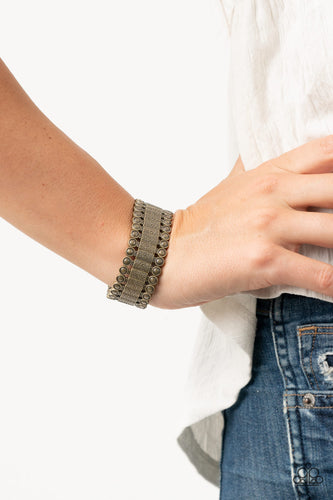 Featuring studded and hammered pieces, decorative rectangular-shaped brass frames are threaded along stretchy bands around the wrist for an authentic look.  Sold as one individual bracelet.   Always nickel and lead free.