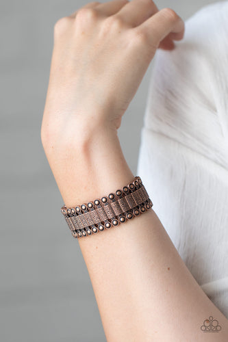 Featuring studded and hammered pieces, decorative rectangular-shaped copper frames are threaded along stretchy bands around the wrist for an authentic look.  Sold as one individual bracelet.   Always nickel and lead free.