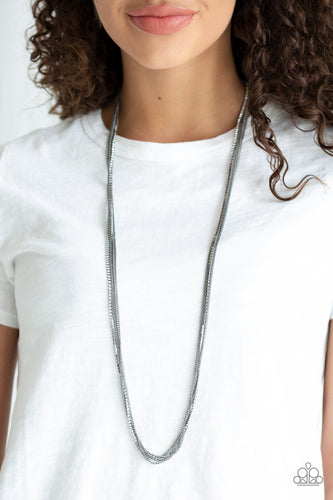 Featuring sleek square fittings, a glittery strand of white rhinestones joins dainty rows of glistening gunmetal chains down the chest for a refined flair. Features an adjustable clasp closure.  Sold as one individual necklace. Includes one pair of matching earrings.  Always nickel and lead free.