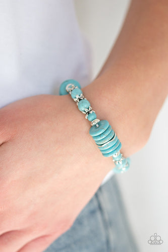 Featuring glistening silver accents, refreshing disc-shaped and round turquoise stone beads are threaded along a stretchy band for a seasonal look.  Sold as one individual bracelet. Always nickel and lead free.