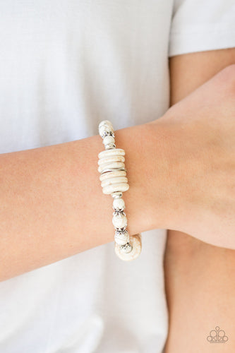 Featuring glistening silver accents, refreshing disc-shaped and round white stone beads are threaded along a stretchy band for a seasonal look.  Sold as one individual bracelet. Always nickel and lead free.