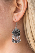 Load image into Gallery viewer, Radiating with a sunburst pattern, a glistening silver frame is dotted with a black bead. Brushed in an antiqued finish, ornate silver teardrops swing from the bottom of the tribal inspired frame, creating a whimsical lure. Earring attaches to a standard fishhook fitting.  Sold as one pair of earrings.  Always nickel and lead free.
