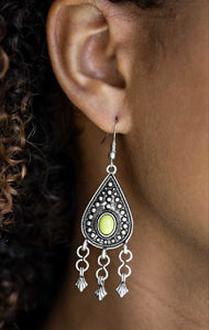 A refreshing green bead is pressed into a glistening silver teardrop dotted with studded textures. The colorful frame gives way to a silver beaded fringe for a whimsical finish. Earring attaches to a standard fishhook fitting.  Sold as one pair of earrings.   By Paparazzi Accessories. Always nickel and lead free.