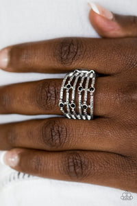 Delicately hammered in shimmer, dainty silver bars stack across the finger, coalescing into an airy band. Glittery black rhinestones dot the bands for a refined finish. Features a stretchy band for a flexible fit.  Sold as one individual ring.  Always nickel and lead free.