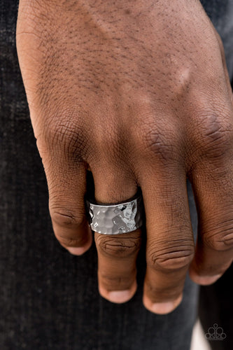 A thick gunmetal band has been hammered in shimmery detail for a metro inspired look. Features a stretchy band for a flexible fit.  Sold as one individual ring.  Always nickel and lead free.