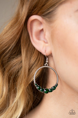 The bottom of a textured silver hoop is encrusted in glittery green rhinestones for a glamorous look. Earring attaches to a standard fishhook fitting.  Sold as one pair of earrings. Always nickel and lead free.
