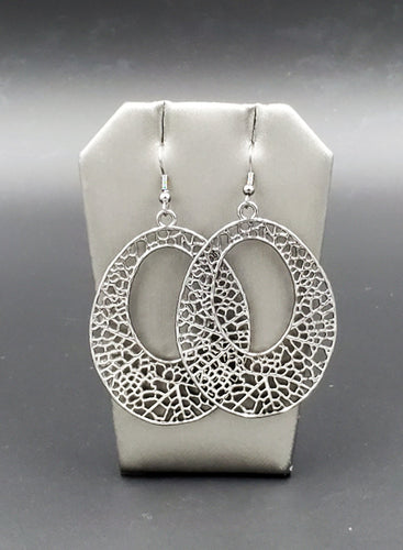 A glistening gunmetal teardrop filigree filled frame swings from the ear for a whimsical look. Earring attaches to a standard fishhook fitting.  Sold as one pair of earrings.  Always nickel and lead free.  Fashion Fix November 2020 Exclusive