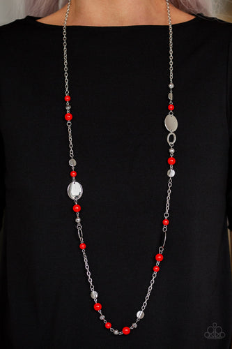 An array of polished red beads, silver discs, and ornate silver accents trickles along a shimmery silver chain for a whimsical look. Features an adjustable clasp closure.  Sold as one individual necklace. Includes one pair of matching earrings. Always nickel and lead free!