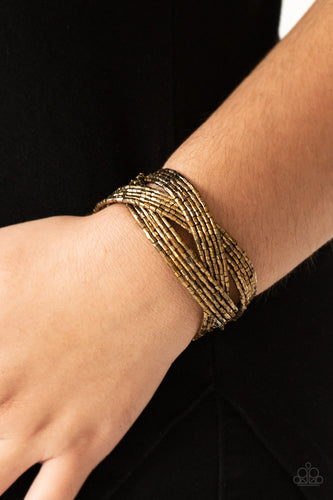 Layers of glistening brass seed beads are braided together to create a breathtaking cuff design that shimmers brilliantly along the wrist.  Sold as one individual bracelet.