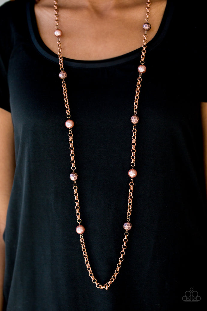 Pearly and faceted copper beads trickle along a bold copper chain, creating a fierce tone on tone palette. Features an adjustable clasp closure.  Sold as one individual necklace. Includes one pair of matching earrings.  Always nickel and lead free.