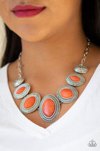 Load image into Gallery viewer, Gradually increasing in size near the center, vivacious orange stones are pressed into textured silver frames below the collar for a tribal inspired look. Features an adjustable clasp closure.  Sold as one individual necklace. Includes one pair of matching earrings. Always nickel and lead free.