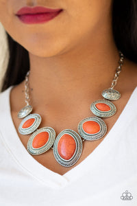 Gradually increasing in size near the center, vivacious orange stones are pressed into textured silver frames below the collar for a tribal inspired look. Features an adjustable clasp closure.  Sold as one individual necklace. Includes one pair of matching earrings. Always nickel and lead free.