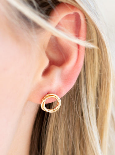 Shimmery gold bars swirl into a dainty hoop for a casual look. Earring attaches to a standard post fitting.  Sold as one pair of post earrings.  Always nickel and lead free.