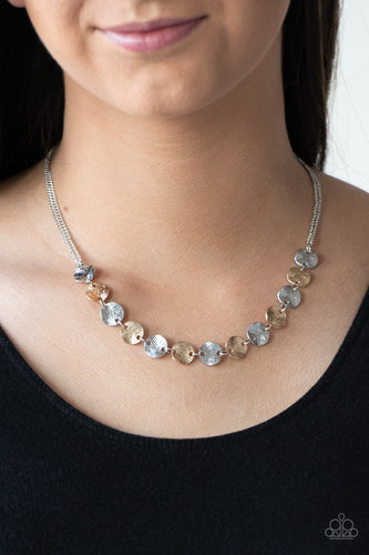 Delicately etched in linear textures, glistening silver and gold discs link below the collar for a casual look. Features an adjustable clasp closure.  Sold as one individual necklace. Includes one pair of matching earrings.  Always nickel and lead free.