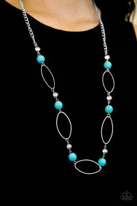 Refreshing turquoise stones and classic silver beads join airy silver hoops along a silver chain for a seasonal look. Features an adjustable clasp closure.  Sold as one individual necklace. Includes one pair of matching earrings.  Always nickel and lead free.