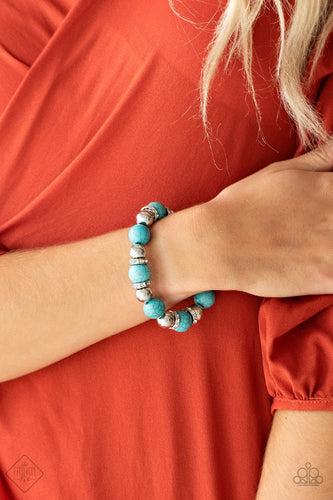 Faux turquoise stones, shiny silver beads, and white rhinestone encrusted rings are threaded along a stretchy band and wrapped around the wrist for an elegantly earthy finish.  Sold as one individual bracelet.   Simply Santa Fe Fashion Fix February 2019    Always nickel and lead free.