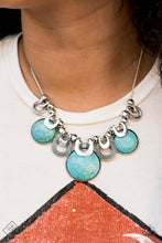 Load image into Gallery viewer,  Infused with silver crescent-shaped fittings, three over sized turquoise stone frames slide along a dainty rounded snake chain. Enhanced with shiny silver beads and ornate hoops, the noise-making collection coalesces below the collar for a bold seasonal look. Features an adjustable clasp closure.